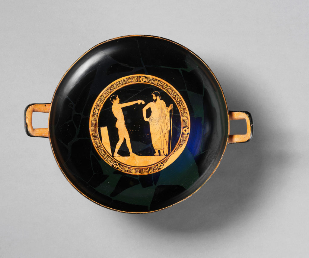 Trinkgeschirr (kylix) um 460 v. Chr. Ein Mentor überwacht das Training eines jungen Athleten im Gymnsium.